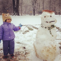 Eloise and what looks like an all-organic snowman made at the park.